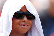 ST. LOUIS, MO - JUNE 30: A young St. Louis Cardinals fan tries to stay cool with a towel and sunglasses while watching the game against the Pittsburgh Pirates at Busch Stadium on June 30, 2012 in St. Louis, Missouri. The Pirates won 7-3 as temperatures reached 103 degrees during the game. (Photo by Joe Robbins)