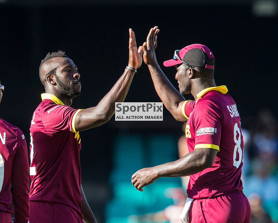 ICC Cricket World Cup 2015 Tournament Match, South Africa v West Indies, Sydney Cricket Ground; 27th February 2015<br /> wicket taker West Indies Andre Russell (left) high fives West Indies Darren Sammy