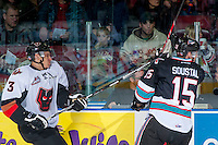 KELOWNA, CANADA - OCTOBER 24: Tomas Soustal #15 of Kelowna Rockets gets a high stick from Jakob LaPointe #3 of Calgary Hitmen on October 24, 2015 at Prospera Place in Kelowna, British Columbia, Canada.  (Photo by Marissa Baecker/Shoot the Breeze)  *** Local Caption *** Tomas Soustal; Jakob LaPointe;