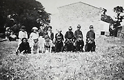 class rural France posing with teachers during a horseback play game France 1930s