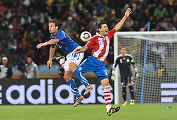 Football - soccer: FIFA World Cup South Africa 2010, Italy (ITA) - Paraguay (PRY), UN CONTRASTO TRA ALBERTO GILARDINO E Antolin Alcaraz