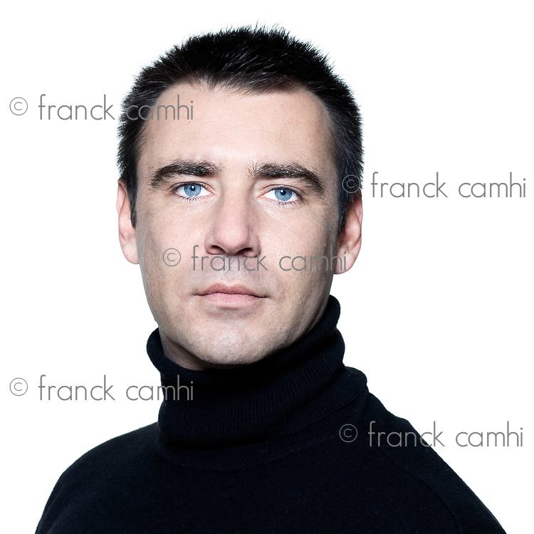 handsome caucasian man serious short brown with polo turtle neck hair blue eyes portrait expressing portrait on studio isolated white background