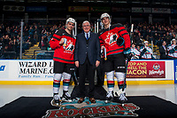 KELOWNA, CANADA - JANUARY 17: Dillon Dube #19 and Cal Foote #25 of the Kelowna Rockets stand with President and General Manger Bruce Hamilton wearing their Team Canada World Jr. Championship jerseys in honour of their gold medal win on January 17, 2017 at Prospera Place in Kelowna, British Columbia, Canada.  (Photo by Marissa Baecker/Shoot the Breeze)  *** Local Caption ***
