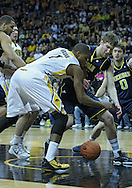 January 14, 2011: Iowa Hawkeyes forward Melsahn Basabe (1) and Michigan Wolverines forward Evan Smotrycz (23) battle for a rebound during the NCAA basketball game between the Michigan Wolverines and the Iowa Hawkeyes at Carver-Hawkeye Arena in Iowa City, Iowa on Saturday, January 14, 2011. Iowa defeated Michigan 75-59.