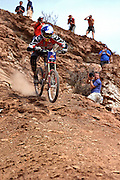 Shaums March ride down a rocky and loose cliff face at the 2002 Red Bull Rampage freeride mountain bike contest in Virgin, Utah.