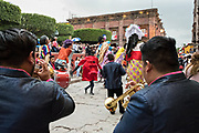 A marching band follows a parade of giant paper-mache puppets called mojigangas in a procession through the city at the start of the week long fiesta of the patron saint Saint Michael September 22, 2017 in San Miguel de Allende, Mexico.