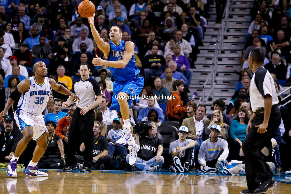 November 17, 2010; New Orleans, LA, USA; Dallas Mavericks power forward Dirk Nowitzki (41) of Germany loses control of the ball as New Orleans Hornets power forward David West (30) defends during the second half at the New Orleans Arena. The Hornets defeated the Mavericks 99-97. Mandatory Credit: Derick E. Hingle