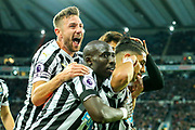 Ayoze Perez (#17) of Newcastle United celebrates Newcastle United's first goal (1-0) with Mohamed Diame (#10) of Newcastle United and Paul Dummett (#3) of Newcastle United during the Premier League match between Newcastle United and Watford at St. James's Park, Newcastle, England on 3 November 2018.