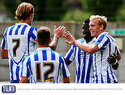 Danny Wright celebrates with his team mates after scoring the third goal for The Robins during the Pre-Season Friendly match between Weston Super Mare and Cheltenham Town at the Woodspring Stadium, Weston Super Mare, United Kingdom on 18 July 2015. Photo by Carl Hewlett