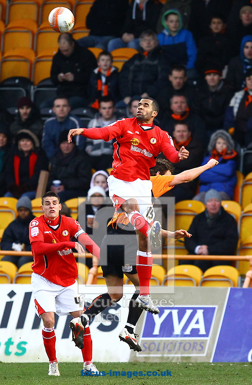 Picture by John Rainford/Focus Images Ltd. 07506 538356.28/01/12.Carl Martin of Crewe Alexandra climbs highest during the Npower League 2 match against Barnet at Underhill Stadium, London.