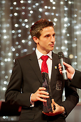 CARDIFF, WALES - Monday, October 8, 2012: Wales' Joe Allen receives the Senior Player of the Year Award during the FAW Player of the Year Awards Dinner at the National Museum Cardiff. (Pic by David Rawcliffe/Propaganda)