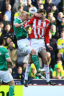Picture by Paul Chesterton/Focus Images Ltd.  07904 640267.03/03/12.Zac Whitbread of Norwich and Peter Crouch of Stoke in action during the Barclays Premier League match at the Britannia Stadium, Stoke-on-Trent.