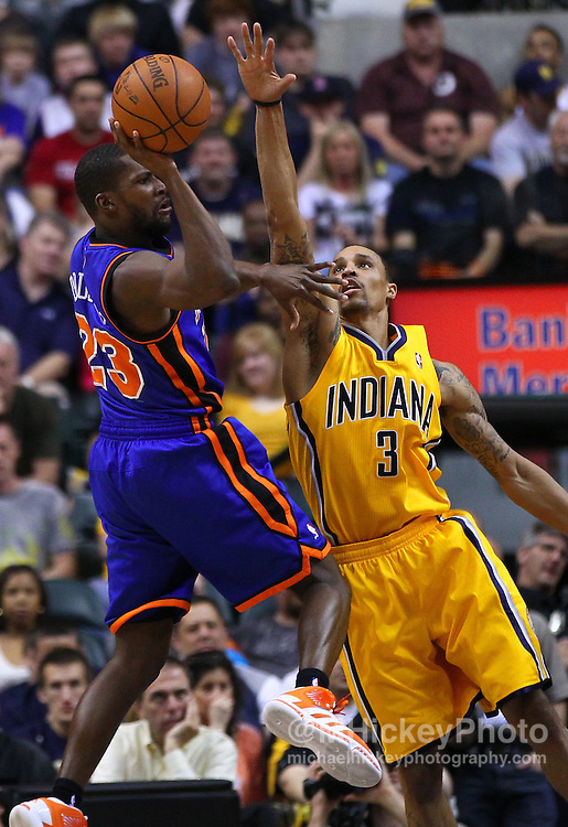 April 03, 2012; Indianapolis, IN, USA; New York Knicks point guard Toney Douglas (23) passes the ball off as Indiana Pacers shooting guard George Hill (3) applies pressure at Bankers Life Fieldhouse. Indiana defeated New York 112-104. Mandatory credit: Michael Hickey-US PRESSWIRE