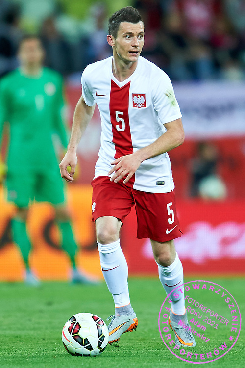 Krzysztof Maczynski from Poland controls the ball during international friendly soccer match between Poland and Greece at PGE Arena Stadium on June 16, 2015 in Gdansk, Poland.<br /> Poland, Gdansk, June 16, 2015<br /> <br /> Picture also available in RAW (NEF) or TIFF format on special request.<br /> <br /> For editorial use only. Any commercial or promotional use requires permission.<br /> <br /> Adam Nurkiewicz declares that he has no rights to the image of people at the photographs of his authorship.<br /> <br /> Mandatory credit:<br /> Photo by &copy; Adam Nurkiewicz / Mediasport