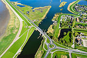 Nederland, Noord-Holland, Gemeente Hollands Kroon, 07-05-2018; Van Ewijcksluis met Balgzandkanaal wat uitmondt in het Amstelmeer. Links de Amsteldiepdijk, ook wel Kleine of Korte Afsluitdijk, richting Wieringen.<br /> Dike connecting former island Wieringen with mainland.<br /> <br /> luchtfoto (toeslag op standaard tarieven);<br /> aerial photo (additional fee required);<br /> copyright foto/photo Siebe Swart