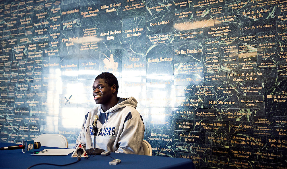 Grand Island Central Catholic senior Youhanna Ghaifan answers questions from the media after signing to the University of Wyoming for football Wednesday at Grand Island Central Catholic in Grand Island. (Independent/Matt Dixon)