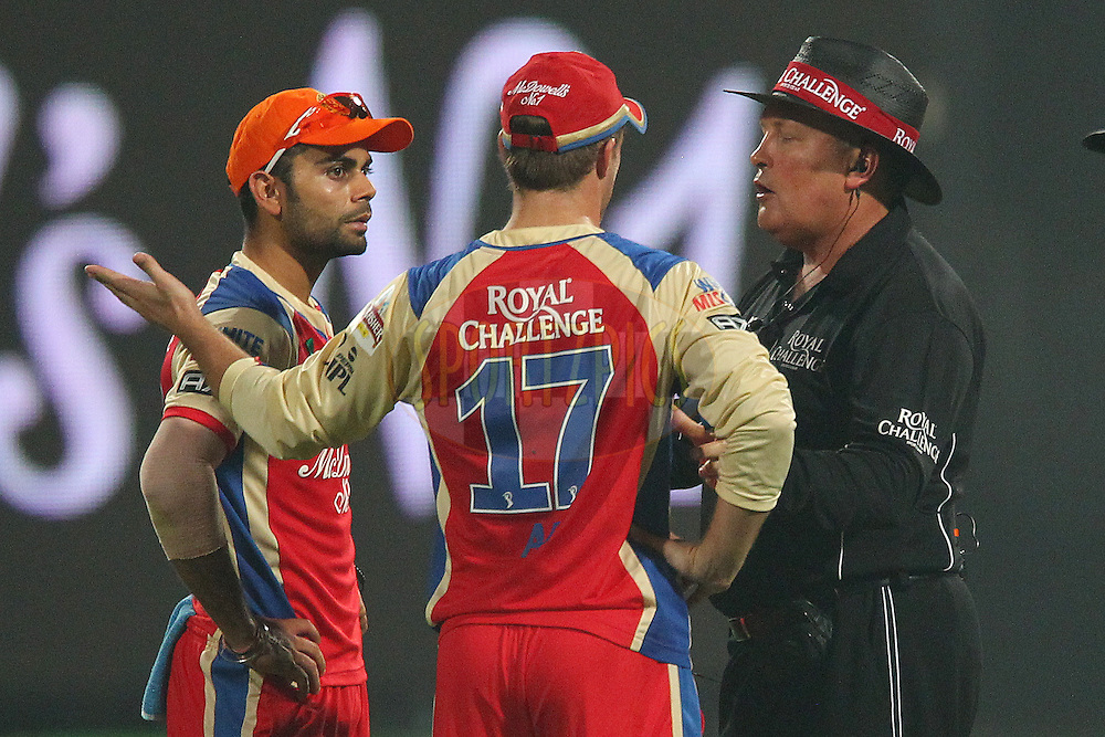 Umpire Marais Erasmus has a word with Virat Kohli and AB de Villiers during match 21 of the Pepsi Indian Premier League between The Royal Challengers Bangalore and The Delhi Daredevils held at the M. Chinnaswamy Stadium, Bengaluru  on the 16th April 2013..Photo by Ron Gaunt-IPL-SPORTZPICS ...Use of this image is subject to the terms and conditions as outlined by the BCCI. These terms can be found by following this link:..http://www.sportzpics.co.za/image/I0000SoRagM2cIEc