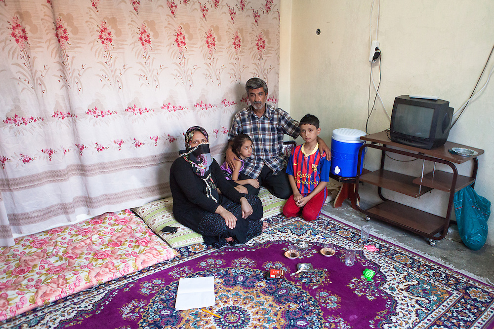 Portrait of a family of Syrian refugees, living in Gaziantep, Turkey.