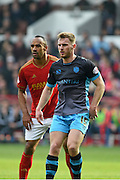 Sheffield Wednesday defender Tom Lees   and Nottingham Forest striker Chris O'Grady during the Sky Bet Championship match between Nottingham Forest and Sheffield Wednesday at the City Ground, Nottingham, England on 12 March 2016. Photo by Jon Hobley.