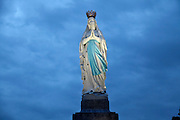 Maria statue in front of basilica of the immaculate conception Notre Dame of Lourdes
