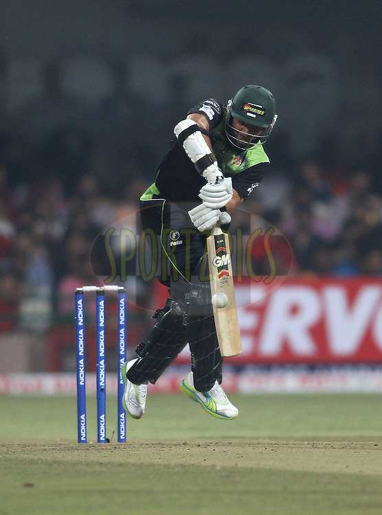 Ashwell Prince of the Warriors gets airborne as he plays a shot during match 1 of the NOKIA Champions League T20 ( CLT20 )between the Royal Challengers Bangalore and the Warriors held at the  M.Chinnaswamy Stadium in Bangalore , Karnataka, India on the 23rd September 2011..Photo by Shaun Roy/BCCI/SPORTZPICS