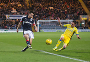 St Johnstone&rsquo;s Danny Swanson dives in to tackle Dundee&rsquo;s Cammy Kerr in the incident which led to the former United man being yellow carded - Dundee v St Johnstone in the Ladbrokes Scottish Premiership at Dens Park, Dundee - Photo: David Young, <br /> <br />  - &copy; David Young - www.davidyoungphoto.co.uk - email: davidyoungphoto@gmail.com