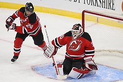 Jan 22, 2013; Newark, NJ, USA; New Jersey Devils goalie Martin Brodeur (30) makes a save while New Jersey Devils defenseman Bryce Salvador (24) defends during the first period at the Prudential Center.