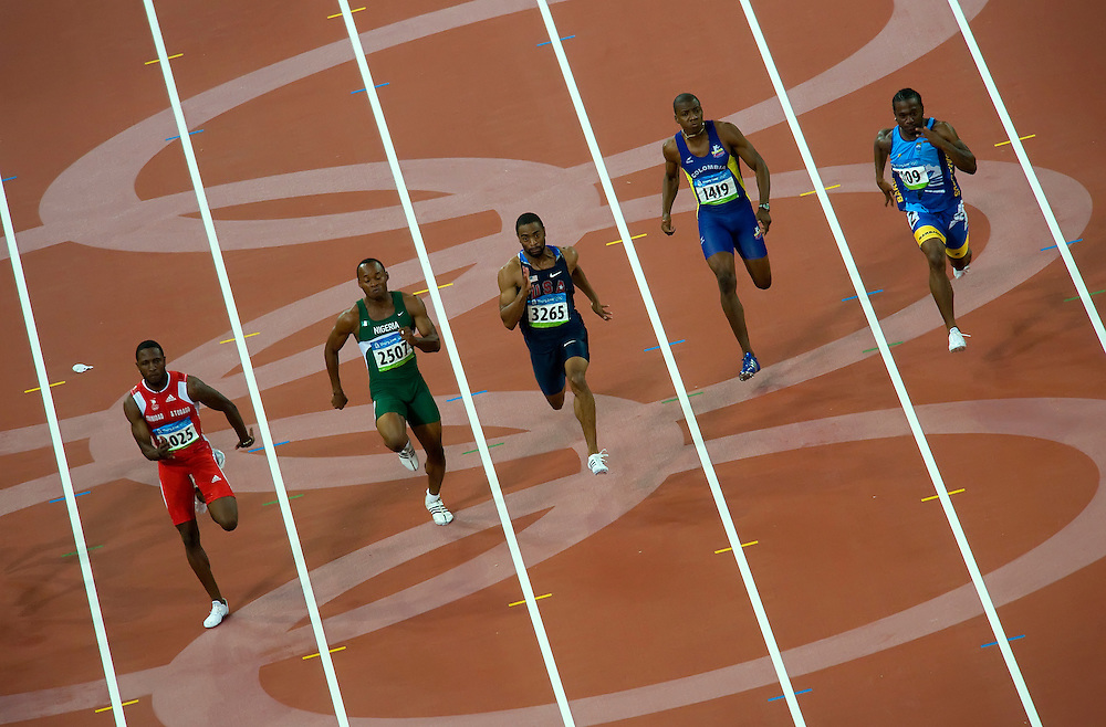 United States sprinter Tyson Gay, center, (3265), ran in the second round of qualifying heats for the men's 100m on August 15, 2008 during the 2008 Summer Olympic Games in Beijing, China. Gay finsihed second in his heat with a time of 10.09. (photo by David Eulitt / MCT)