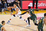 Golden State Warriors guard Stephen Curry (30) attacks the basket against the Utah Jazz at Oracle Arena in Oakland, Calif., on December 20, 2016. (Stan Olszewski/Special to S.F. Examiner)