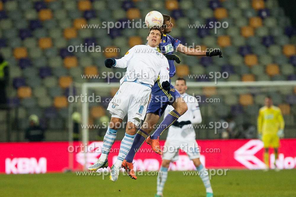 Hernanes #8 of S.S. Lazio and Zeljko Filipovic #5 of Maribor during football match between NK Maribor and S. S. Lazio Roma  (ITA) in 6th Round of Group Stage of UEFA Europa league 2013, on December 6, 2012 in Stadium Ljudski vrt, Maribor, Slovenia. (Photo By Gregor Krajncic / Sportida)