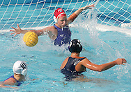 US player Thalia Munro (13) in action as Australian goalie Jemma Brownlow (red) defends during the  United States vs Australian bronze medal match in the Women's Water Polol at theOlympicv Aquatic Centre in Athens Thursday 26 August 2004.  The US won 6 to 5 to win the bronze. (Photo by Patrick B. Kraemer / MAGICPBK)