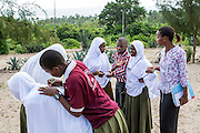 Local teacher Rebecca Ngovano monitoring another teacher during a geography class outside in the school grounds. Rebecca has been working with VSO volunteer for over 6 months to improve teaching methodologies in classrooms. Angaza school, Lindi, Tanzania