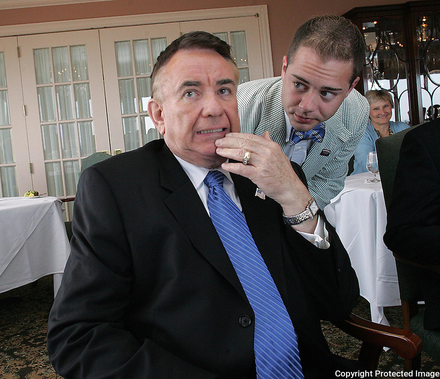 THOMPSON - DES MOINES, JUNE 20 -- Presidential candidate Tommy Thompson gets some last minute advice from staff member Rennick Remley Tuesday before speaking at the Embassy Club, Ruan Center.  m0620thompson  DAVID PETERSON/THE REGISTER  Des Moines, Ia., April 25, 2009 - DRAKE RELAYS PHOTOGRAPH BY DAVID PETERSON -