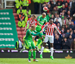 STOKE-ON-TRENT, ENGLAND - Saturday, April 30, 2016: Stoke City's Peter Crouch in action against Sunderland's Wabi Khazri during the FA Premier League match at the Britannia Stadium. (Pic by David Rawcliffe/Propaganda)