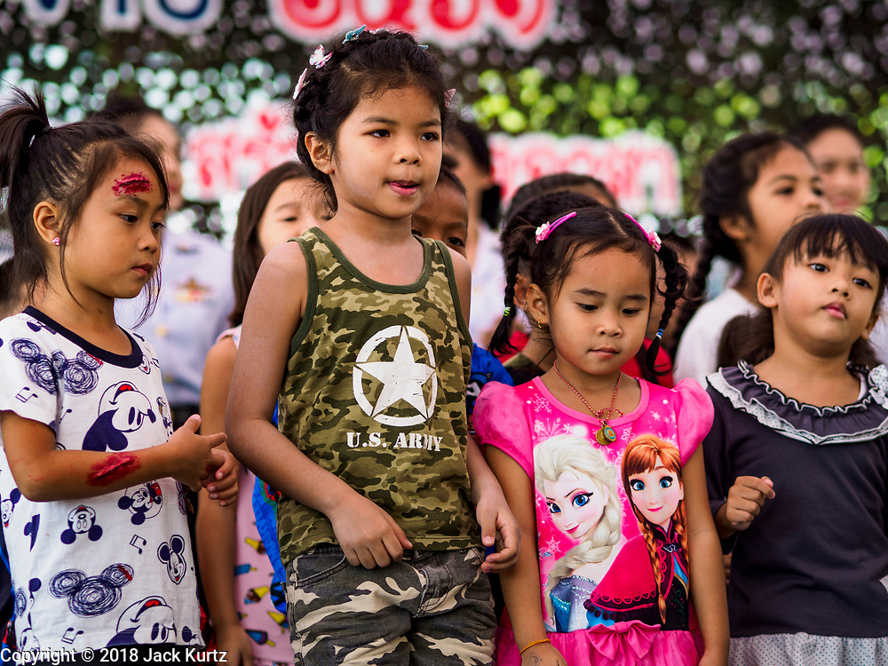 """13 JANUARY 2018 - BANGKOK, THAILAND:        Thai children dance during Children's Day activities at the Royal Thai Army's King's Guard 2nd Cavalry Camp in central Bangkok. Children's Day is called """"Wan Dek"""" in Thai. Many government offices and military bases hold special activities for children as do shopping malls.  PHOTO BY JACK KURTZ"""