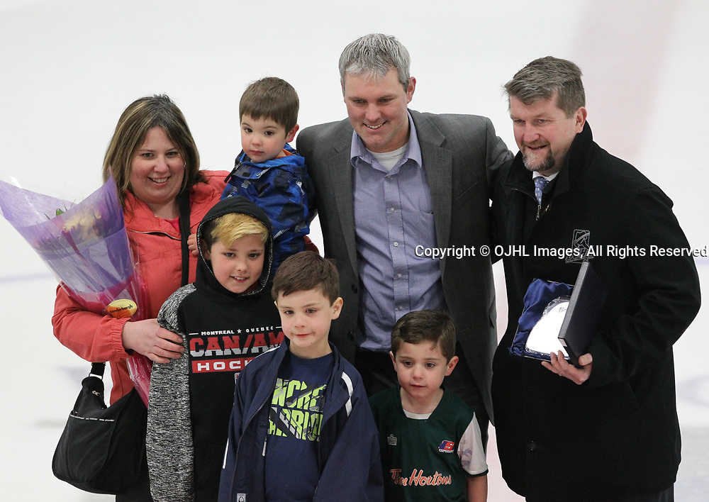 GEORGETOWN, ON  - APR 18,  2017: Ontario Junior Hockey League, Championship Series. Georgetown Raiders vs the Trenton Golden Hawks in Game 3 of the Buckland Cup Final. Izak Westgate and family pose with OJHL Chairman of the Board Scott McCrory. Westgate was the recipient of the 2016-17 Chairman's Award.<br /> (Photo by Tim Bates / OJHL Images)
