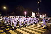 """01 FEBRUARY 2013 - PHNOM PENH, CAMBODIA:  A military marching band walks along Sisowath Quay in the morning of Feb 1, before Sihanouk's funeral procession left the palace. Norodom Sihanouk (31 October 1922- 15 October 2012) was the King of Cambodia from 1941 to 1955 and again from 1993 to 2004. He was the effective ruler of Cambodia from 1953 to 1970. After his second abdication in 2004, he was given the honorific of """"The King-Father of Cambodia."""" Sihanouk died in Beijing, China, where he was receiving medical care, on Oct. 15, 2012. His cremation is will be on Feb. 4, 2013. Over a million people are expected to attend the service.   PHOTO BY JACK KURTZ"""
