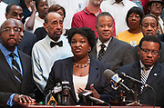 "House Minority Leader Stacey Abrams announces to reporters that more than 51,000 voter applications submitted by the New Georgia Project have not yet been processed by the secretary of state's offices run by republican Brian Kemp. ""We have raised questions today, and we will keep asking them until these voters are on the rolls,"" Abrams said in a statement. ""Georgians deserve answers to why their voter registrations have been ignored."" Abrams spoke inside the Georgia state capitol surrounded by activists and voter registration applications  less than two months before the 2014 elections."