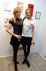 Left to right, sisters ALEXIA INGE and Model OLIVIA INGE  at the Alive & Well Dog Project Auction auction in aid of the Great Ormond Street Hospital Children's Charity at The Hospital, 24 Endell Street, London WC2 on 31st January 2007.<br />