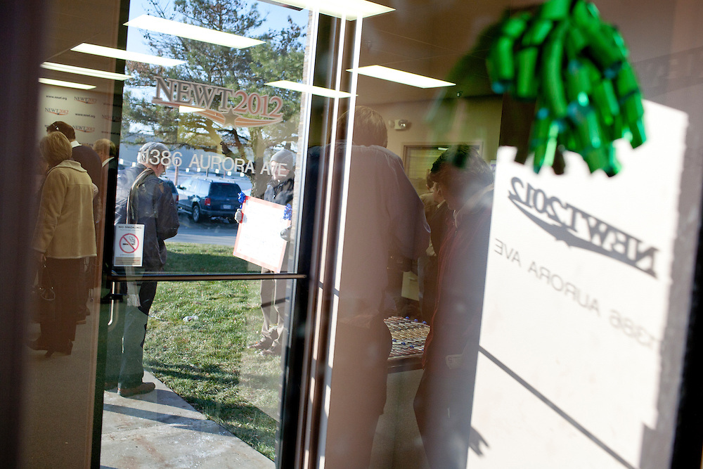 People arrive for the opening of a new campaign office for Republican presidential candidate Newt Gingrich on Saturday, December 10, 2011 in Urbandale, IA.