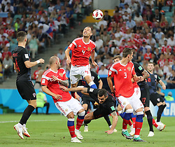 SOCHI, July 7, 2018  Sergey Ignashevich (top) of Russia competes for a header during the 2018 FIFA World Cup quarter-final match between Russia and Croatia in Sochi, Russia, July 7, 2018. (Credit Image: © Yang Lei/Xinhua via ZUMA Wire)