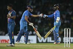 March 12, 2018 - Colombo, Sri Lanka - Indian cricketers Dinesh Karthik and Manish Pandey congratulate each other after winning the  4th Twenty-20 cricket match of NIDAHAS Trophy between Sri Lanka  and India at R Premadasa cricket ground, Colombo, Sri Lanka on Monday 12 March 2018. (Credit Image: © Tharaka Basnayaka/NurPhoto via ZUMA Press)