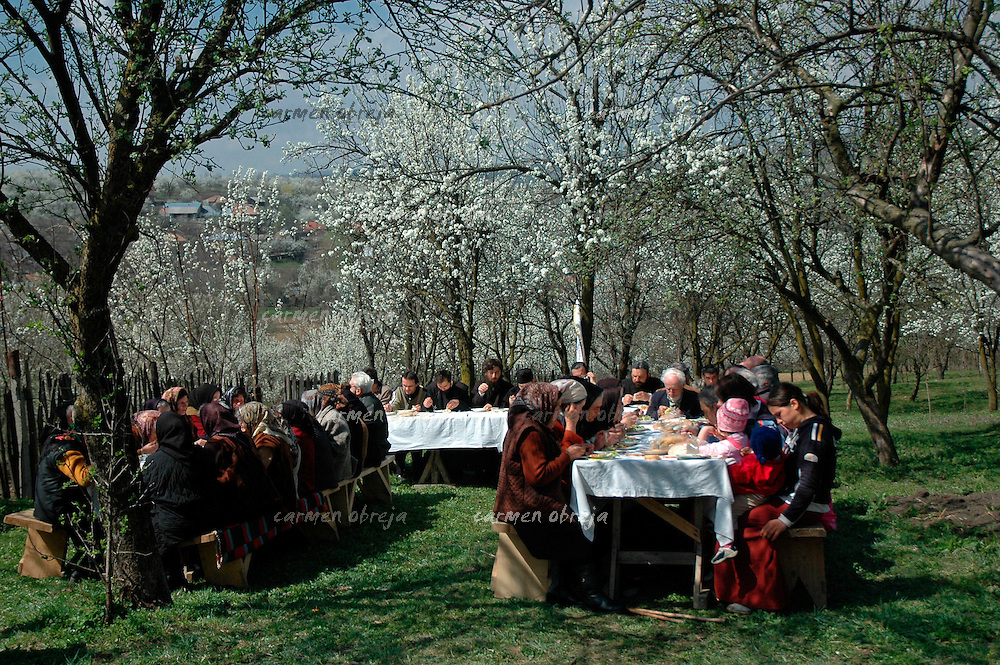villagers gathered in the garden of a cottage to enjoy a holiday feast