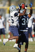 OXNARD, CA - AUGUST 17:  Wide receiver Jamaica Rector #85 of the Dallas Cowboys goes airborne to catch a pass while defended by cornerback Lenny Williams #34 during Dallas Cowboys training camp on August 17, 2006 in Oxnard, California. ©Paul Anthony Spinelli *** Local Caption *** Jamaica Rector;Lenny Williams