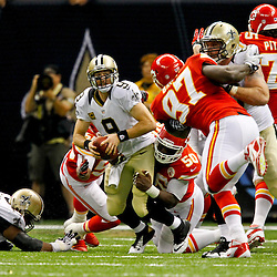 September 23, 2012; New Orleans, LA, USA; New Orleans Saints quarterback Drew Brees (9) is sacked by Kansas City Chiefs linebacker Justin Houston (50) during the fourth quarter of a game at the Mercedes-Benz Superdome. The Chiefs defeated the Saints 27-24 in overtime. Mandatory Credit: Derick E. Hingle-US PRESSWIRE