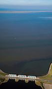 Nederland, Groningen, Lauwersoog, 08-09-2009; R.J. Cleveringsluizen,  de spuisluizen zijn uitwaterende sluizen en liggen tussen Waddenzee en  Lauwersmeer (voormalige Lauwerszee). Schiermonnikoog aan de horizon..luchtfoto (toeslag); aerial photo (additional fee required); .foto Siebe Swart / photo Siebe Swart