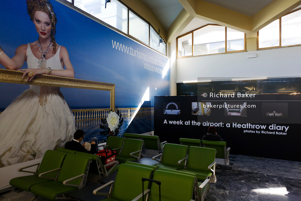 """Richard Baker's photography exhibition from the Alain de Botton book 'A Week at the Airport: A Heathrow Diary"""" (2009), on show at Pisa Airport, Italy as part of the Festival della Creativita, 2010."""