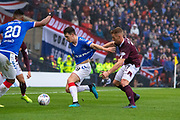 Oliver Bozanic of Hearts gets a handful of Ryan Jack of Rangers FC shirt during the Betfred Scottish League Cup semi-final match between Rangers and Heart of Midlothian at Hampden Park, Glasgow, United Kingdom on 3 November 2019.