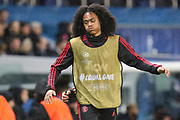 Manchester United Forward Tahith Chong warms up as a substitute during the Champions League Round of 16 2nd leg match between Paris Saint-Germain and Manchester United at Parc des Princes, Paris, France on 6 March 2019.