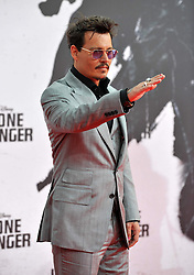 The Lone Ranger Berlin film premiere.<br /> Johnny Depp attends premiere of latest adaptation of well-known Spaghetti Western. <br /> Berlin, Germany<br /> Friday 19 July 2013<br /> Picture by Schneider-Press / John Farr / i-Images<br /> UK & USA ONLY